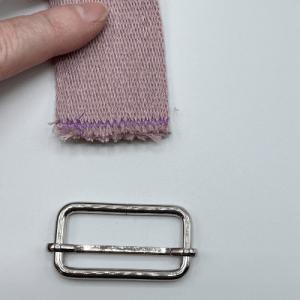 Gurtband und Versteller